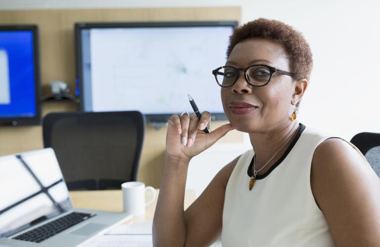Confident woman at her desk