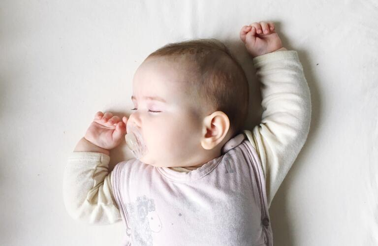 sleeping infant with pacifier