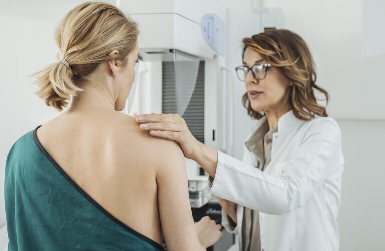 Woman prepped for mammogram