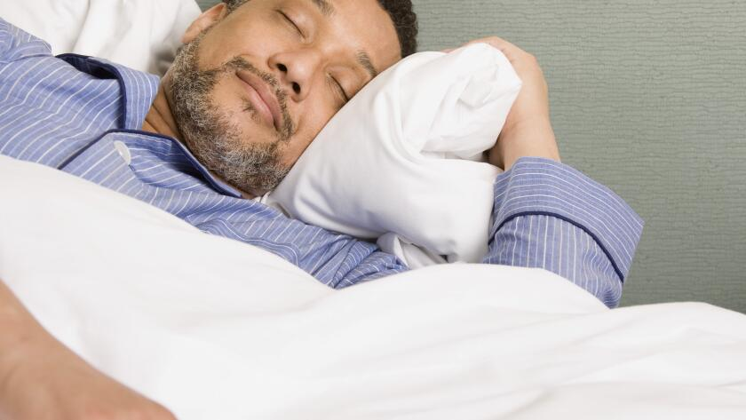 man with beard sleeping in bed