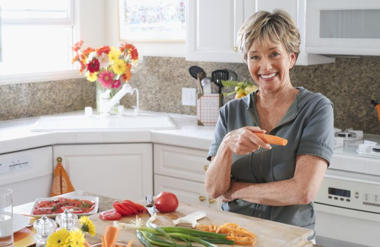 older woman smiling in the kitchen
