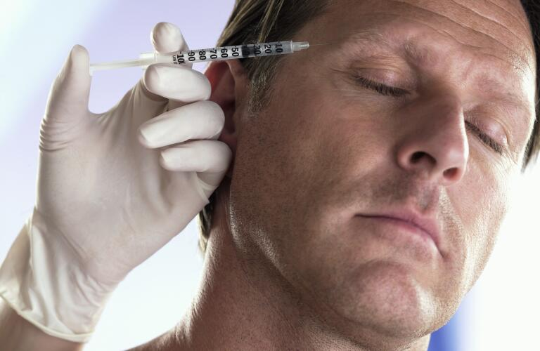 Mature Man Receiving Injection in Forehead