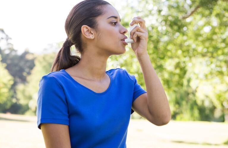 woman-using-inhaler-outside