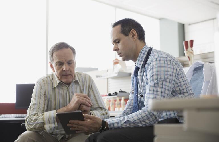 senior-man-talking-with-doctor