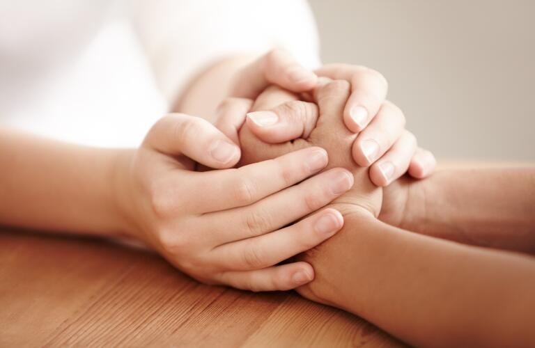 holding-hands-on-table