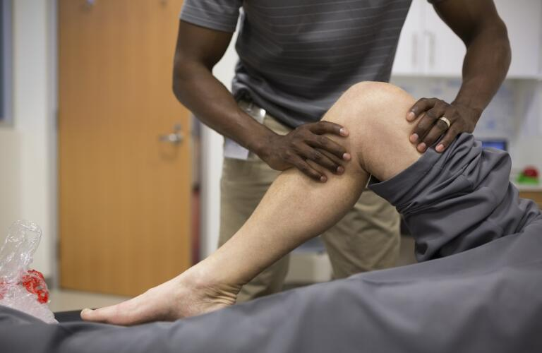 physical-therapist-stretching-patients-leg