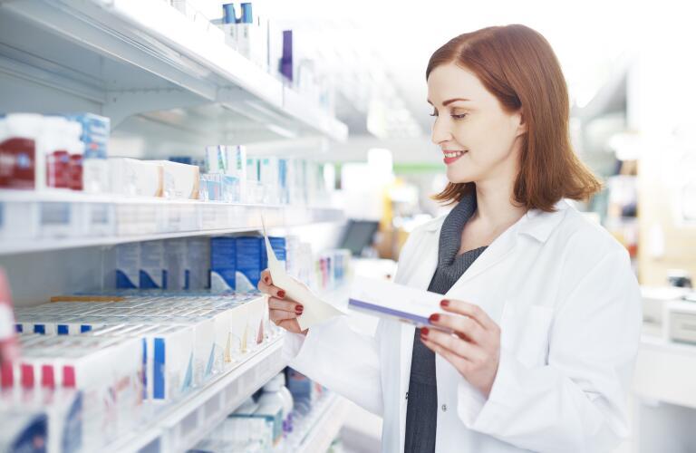 female-pharmacist-reading-prescription