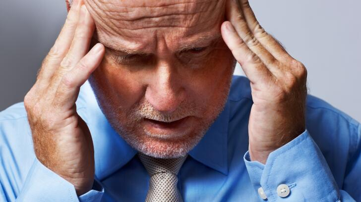 stressed-man-with-hands-on-head