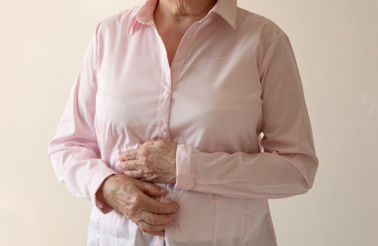 Older woman with stomach pain