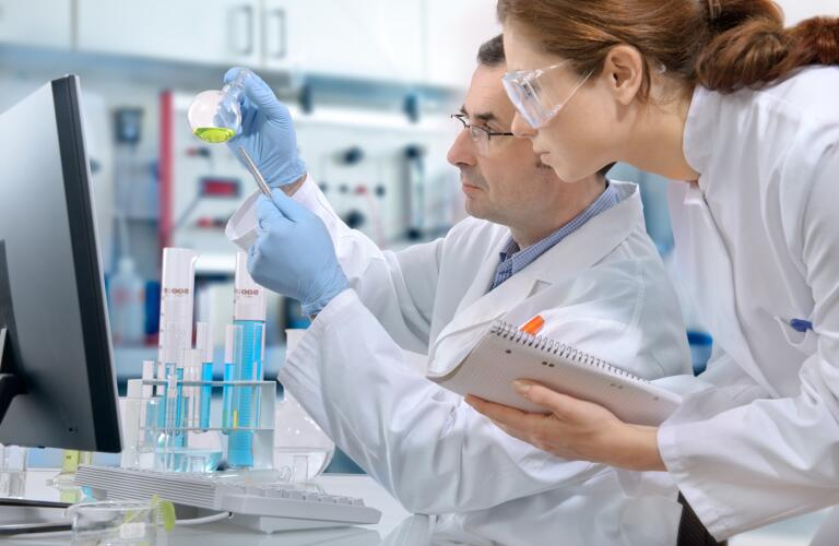 two-people-in-laboratory-looking-at-samples