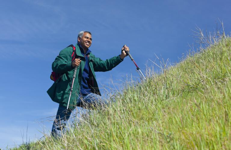 man-hiking-up-hill
