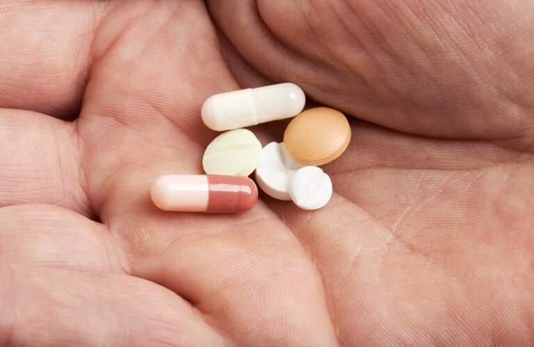 variety-of-pills-in-hand