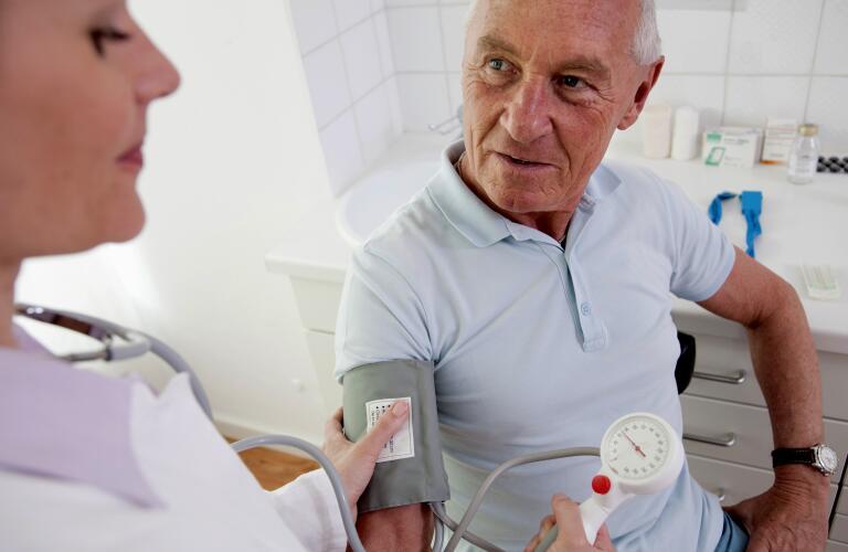 Doctor patient's taking blood pressure