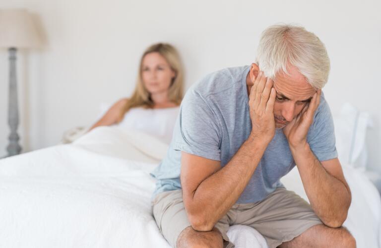 Older man in bed