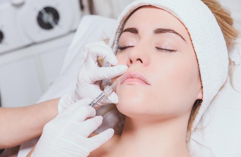 Woman having cosmetic procedure