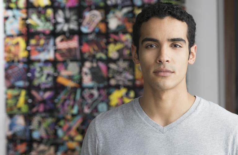 serious Hispanic male in art studio