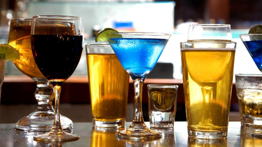 mixture of wine, liquor, beer glasses on bar