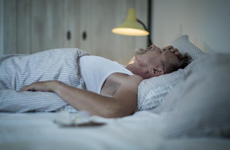 Senior Caucasian man in bed  with insomnia