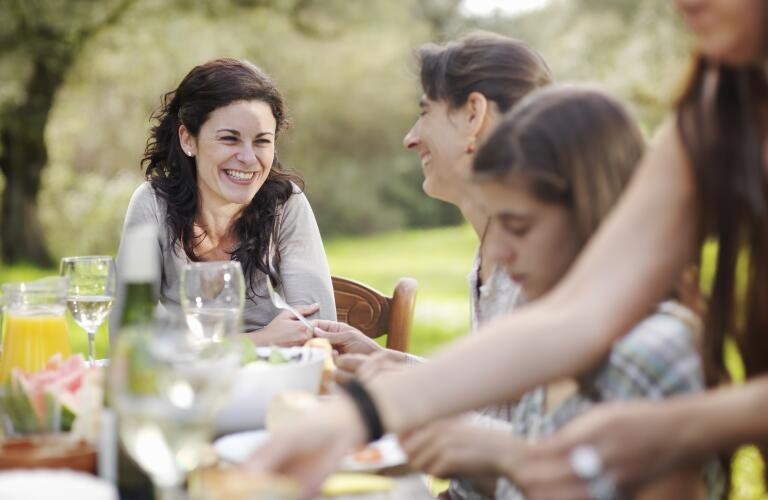 friends-sitting-at-outdoor-dinner-table