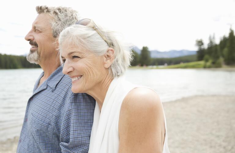senior-couple-walking-by-water