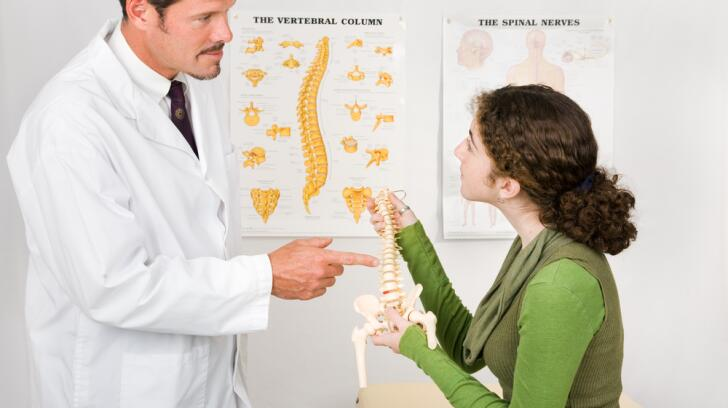 Chiropractor consulting with patient