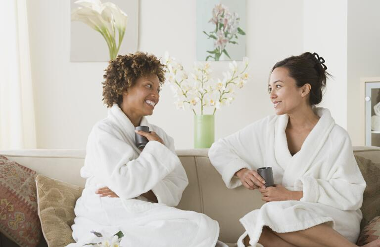 two women relaxing and smiling at spa