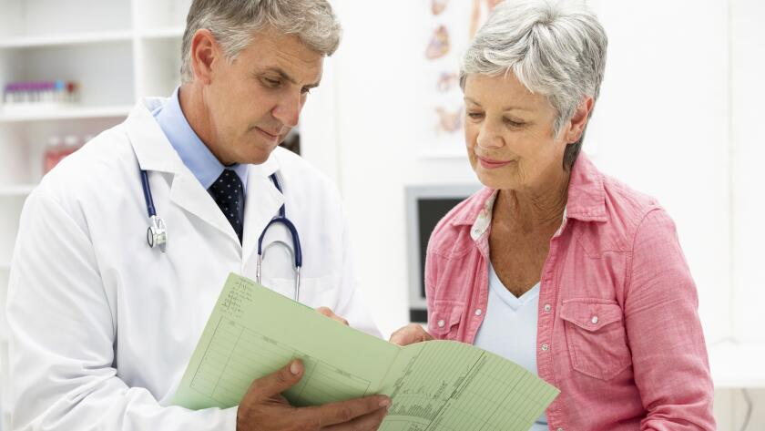 Doctor with senior female patient