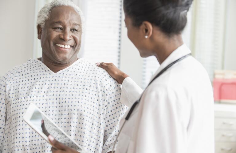 Doctor comforting older man