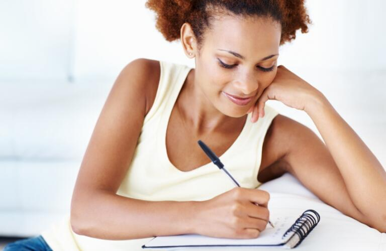 Woman making to do list