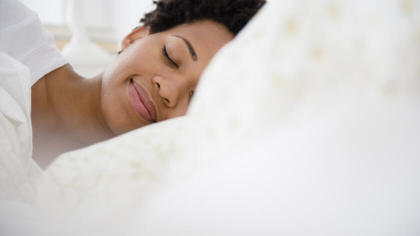 peaceful-woman-sleeping-in-bed