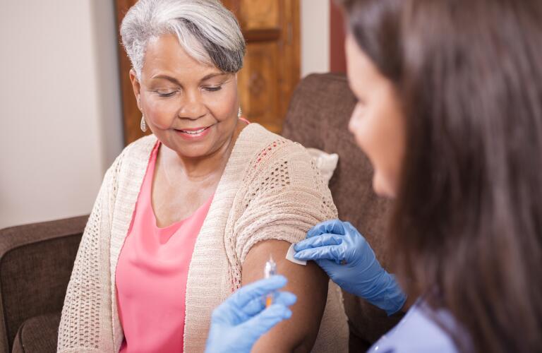 senior woman receiving injection