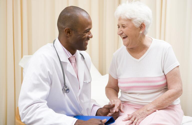 Doctor laughing with senior female patient