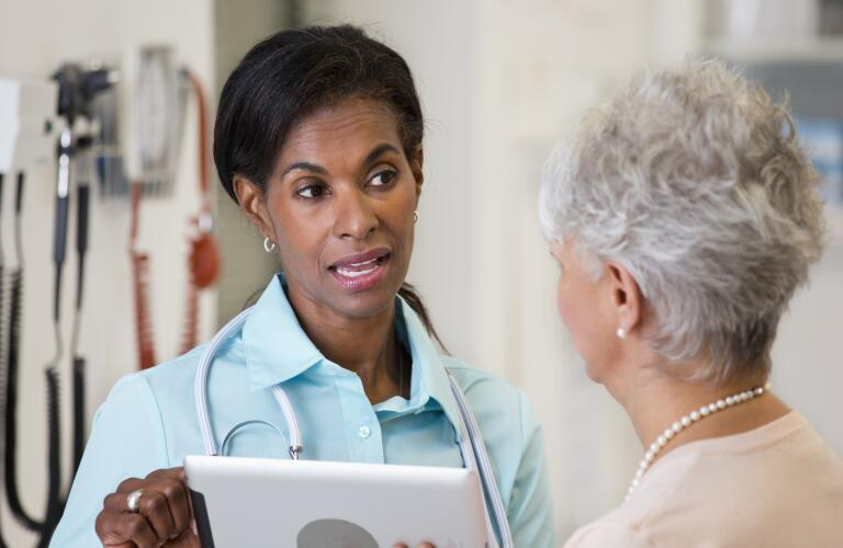 tech savvy doctor talking to patient