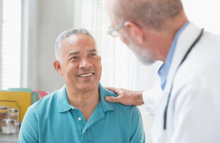 Doctor Talking to Man in Office