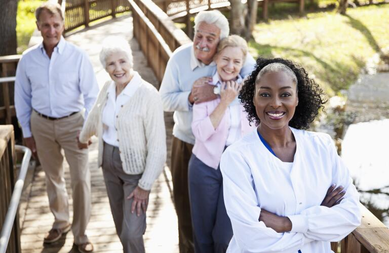 health professional and senior couples