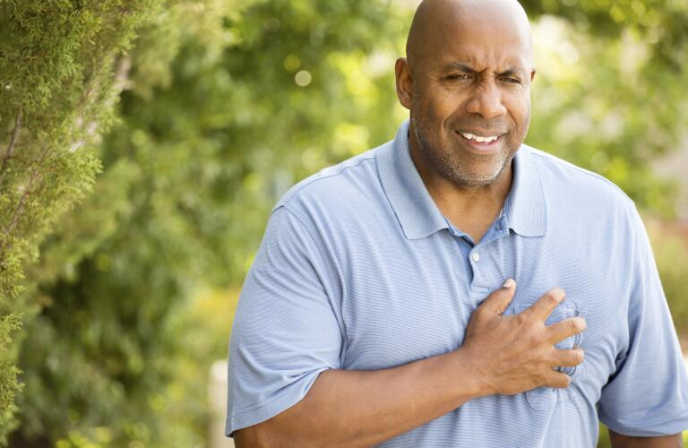 man-outside-experiencing-chest-pain