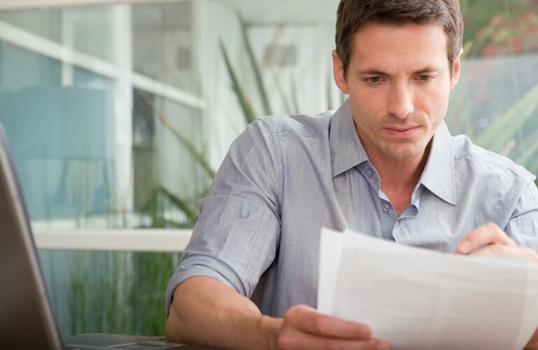 male reading paperwork