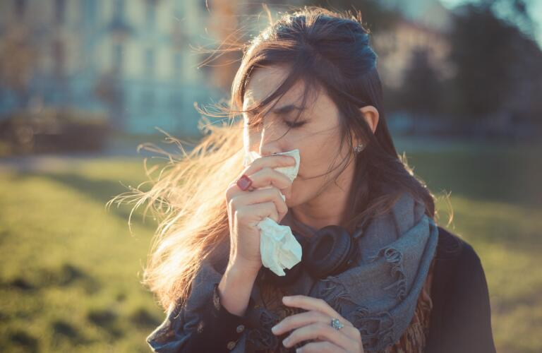 woman-with-flu-blowing-nose