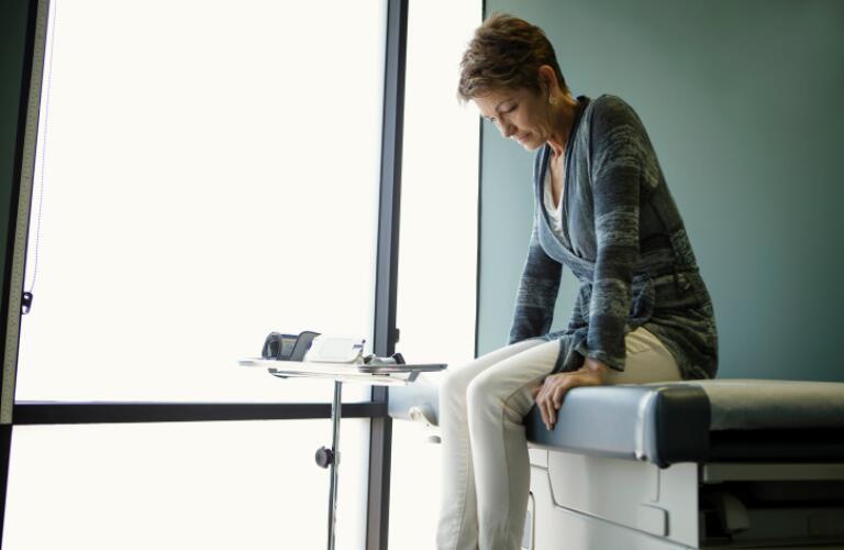 Senior woman sitting on hospital bed