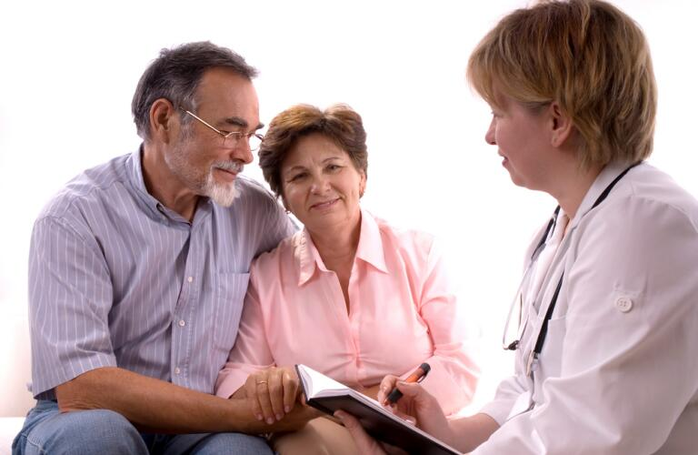 Couple visiting with doctor