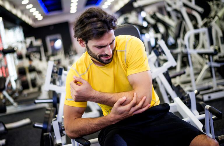 Man at gym injures elbow