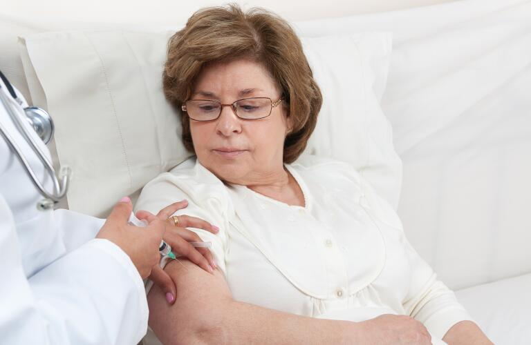 patient receiving injection in arm