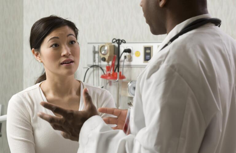 doctor explaining medical problem to patient