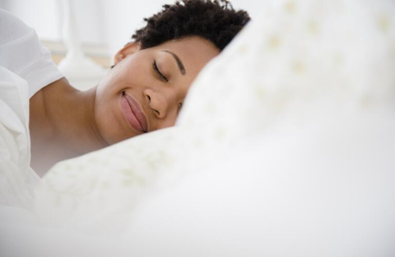 peaceful-woman-sleeping-in-bed