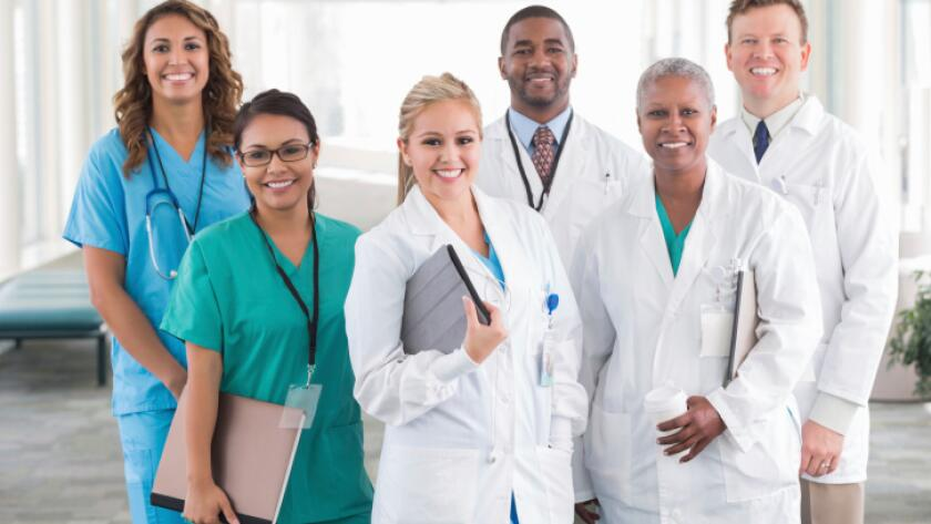 Large diverse group of hospital doctors, surgeons, and nurses