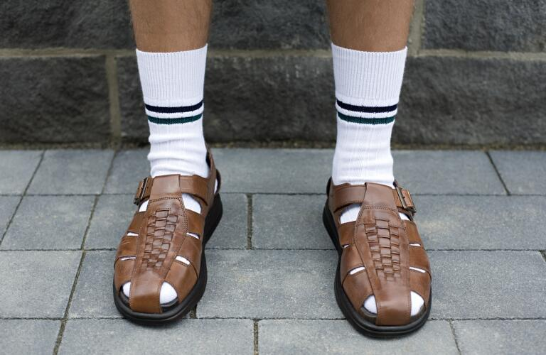 unidentified man wearing white crew socks with sandals
