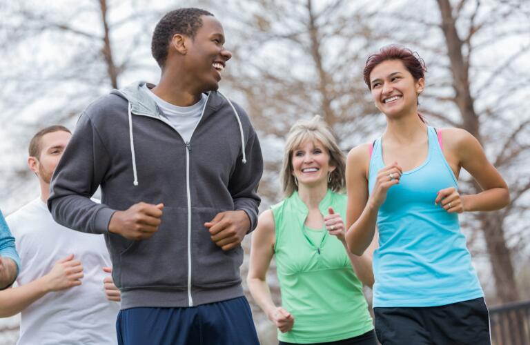 Young couple going for run with running club together