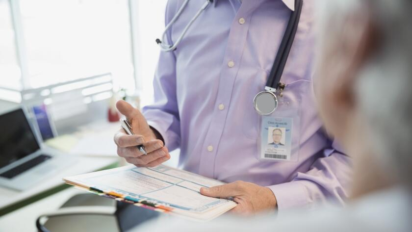 doctor-giving-diagnosis-to-patient