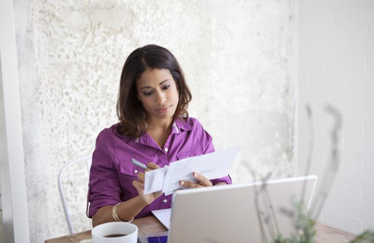 woman-paying-bills