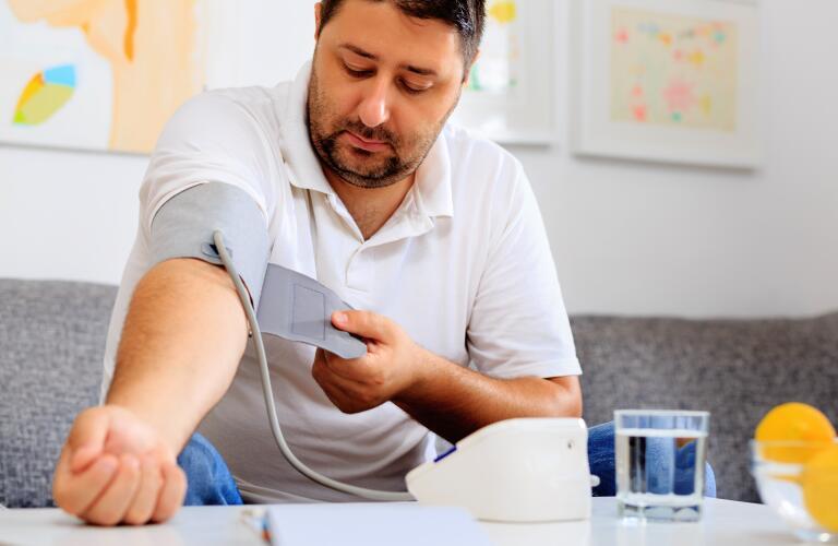 Male taking blood pressure